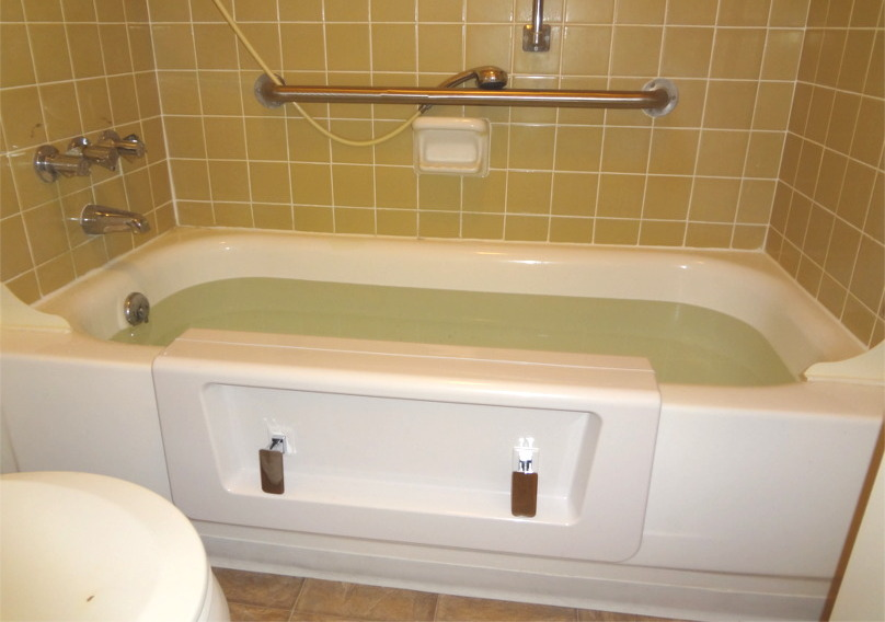 Bathtub converted to walk-in shower